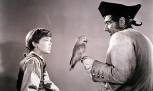 Confrontation: Jim Hawkings (Bobby Driscoll) meets Long John Silver (Robert Newton) in the 1950 movie of Treasure Island